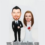 Typical Bride and Groom Wedding Pose Red Rose Bobblehead