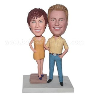 Woman Stands On the Travel Suitcase Arm Around Groom Bobblehead
