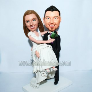 Custom Groom Holds Wife Wedding Bobbleheads