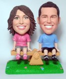 See Saw Couple On the Lawn Bobble Head Dolls