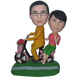 Custom Couple Bobble Heads Riding Bike With Roses