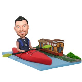 Canoe Male Paddle On the River Next To The Hutch Bobbleheads