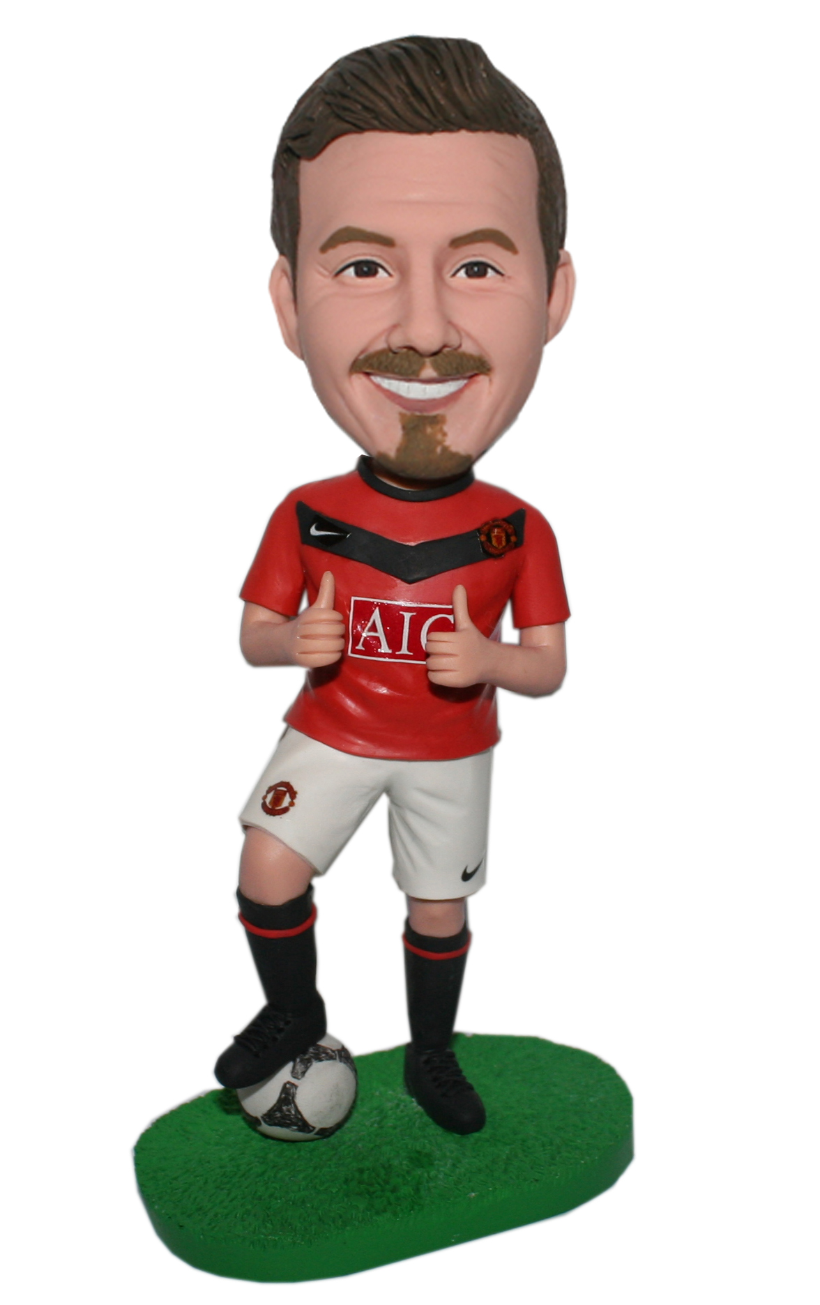 Right Foot Rests On The Soccer Ball Bobble Head Doll